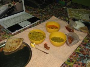 Indian food: cabbage chana dal, dalimbi usal, pea paneer, chappati, and onion bhaji